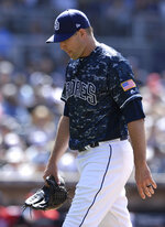 San Diego Padres relief pitcher Craig Stammen walks to the dugout after recording the last out of the top of the eighth inning of a baseball game against the Washington Nationals, Sunday, June 9, 2019, in San Diego. (AP Photo/Orlando Ramirez)