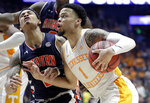 Tennessee's Lamonte Turner (1) collides with Auburn's Bryce Brown on his way to the basket in the second half of the NCAA college basketball Southeastern Conference championship game Sunday, March 17, 2019, in Nashville, Tenn. (AP Photo/Mark Humphrey)