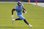 Tennessee Titans wide receiver Corey Davis (84) carries the ball against the Cleveland Browns in the second half of an NFL football game Sunday, Dec. 6, 2020, in Nashville, Tenn. (AP Photo/Wade Payne)