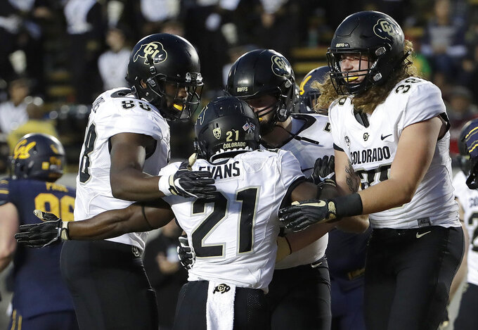 Colorado running back Kyle Evans (21) is congratulated by teammates after scoring against California during the first half of an NCAA college football game in Berkeley, Calif., Saturday, Nov. 24, 2018. (AP Photo/Jeff Chiu)