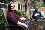 """Bethany Racobs-Ashford poses for a photo with her husband, Chase, at her mother's home in Dallas, Wednesday, Aug. 5, 2020. Racobs-Ashford said that the extra $600 in federal benefits was a """"lifeline"""