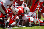 Miami of Ohio running back Tyre Shelton (20) scores a touchdown in the first half of an NCAA college football game against Cincinnati, Saturday, Sept. 14, 2019, in Cincinnati. (AP Photo/John Minchillo)