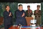 This Saturday, Aug. 24, 2019, photo provided Sunday, Aug. 25, by the North Korean government, shows North Korean leader Kim Jong Un, center, claps hands as Kim watches the test firing of an unspecified missile at an undisclosed location in North Korea. North Korea fired two suspected short-range ballistic missiles off its east coast on Saturday in the seventh weapons launch in a month, South Korea's military said, a day after it vowed to remain America's biggest threat in protest of U.S.-led sanctions on the country. The content of this image is as provided and cannot be independently verified. Korean language watermark on image as provided by source reads: