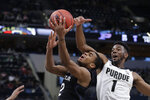 Butler's Aaron Thompson (2) is fouled by Purdue's Aaron Wheeler (1) during the second half of an NCAA college basketball game, Saturday, Dec. 21, 2019 in Indianapolis. Butler won 70-61. (AP Photo/Darron Cummings)