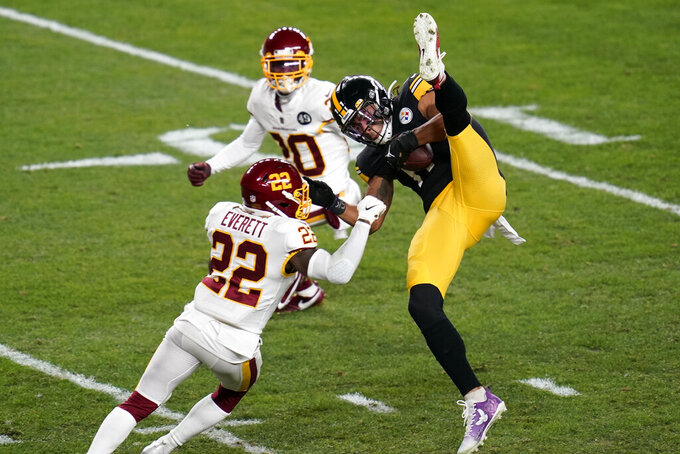 Pittsburgh Steelers wide receiver Chase Claypool (11) makes a catch with Washington Football Team free safety Deshazor Everett (22) defending during the first half of an NFL football game, Monday, Dec. 7, 2020, in Pittsburgh. (AP Photo/Keith Srakocic)
