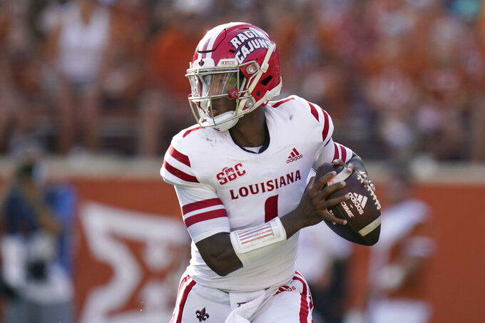 Louisiana Lafayette quarterback Levi Lewis (1) looks to throw against Texas during the second half of an NCAA college football game, Saturday, Sept. 4, 2021, in Austin, Texas. (AP Photo/Eric Gay)