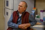 """This image released by Hulu shows Michael Keaton in a scene from """"Dopesick,"""" an eight-part miniseries about America's opioid crisis, premiering Wednesday with three episodes. (Gene Page/Hulu via AP)"""