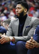New Orleans Pelicans forward Anthony Davis watches from the bench during the first half of the team's NBA basketball game against the Houston Rockets, Tuesday, Jan. 29, 2019, in Houston. (AP Photo/Eric Christian Smith)