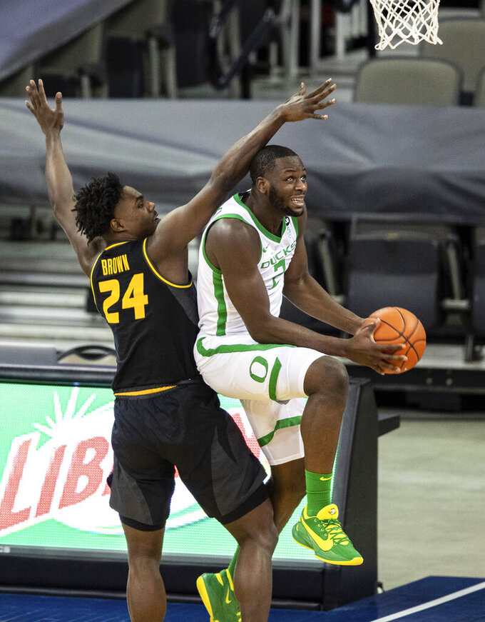 Missouri's Kobe Brown (24) fouls Oregon's Eugene Omoruyi during an NCAA college basketball game, Wednesday, Dec. 2, 2020 in Omaha, Neb. (Chris Machian/Omaha World-Herald via AP)