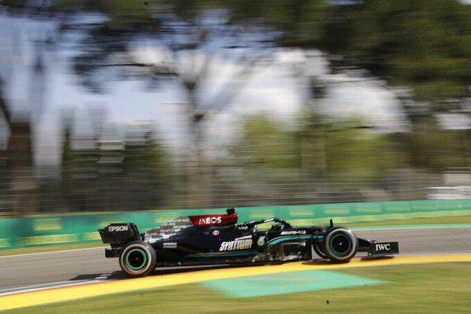 Mercedes driver Lewis Hamilton of Britain steers his car during free practice for Sunday's Emilia Romagna Formula One Grand Prix, at the Imola track, Italy, Friday, April 16, 2021. (AP Photo/Luca Bruno)