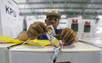 A worker prepares a ballot box to be distributed to polling stations in in Jakarta, Indonesia, Tuesday, April 16, 2019. The world's third largest democracy is gearing up to hold its legislative and presidential elections that will pit the incumbent Joko Widodo against his contender former special forces general Prabowo Subianto.(AP Photo/Achmad Ibrahim)