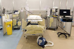 In this photo taken on Tuesday, March 31, 2020, medical equipment is labelled and prepared for use at the ExCel centre which is being made into a temporary hospital, in London. The new hospital - the NHS Nightingale, will comprise of two wards, each of 2,000 people, to help tackle coronavirus. The new coronavirus causes mild or moderate symptoms for most people, but for some, especially older adults and people with existing health problems, it can cause more severe illness or death. (Stefan Rousseau/Pool Photo via AP)