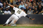 Milwaukee Brewers' Tyrone Taylor gestures after sliding safely into home to score during the fourth inning of a baseball game against the Chicago White Sox, Saturday, July 24, 2021, in Milwaukee. (AP Photo/Aaron Gash)