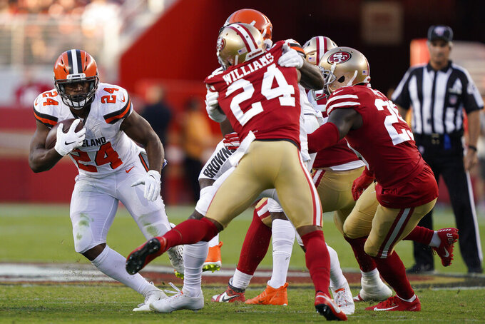 Cleveland Browns running back Nick Chubb, left, runs against the San Francisco 49ers during the first half of an NFL football game in Santa Clara, Calif., Monday, Oct. 7, 2019. (AP Photo/Tony Avelar)