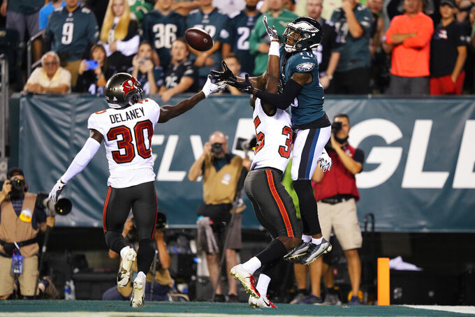 Philadelphia Eagles wide receiver Quez Watkins (16) can't catch a pass during the second half of an NFL football game against the Tampa Bay Buccaneers on Thursday, Oct. 14, 2021, in Philadelphia. (AP Photo/Matt Slocum)
