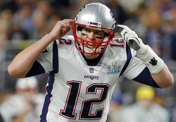 FILE - In this Feb. 4, 2018, file photo, New England Patriots quarterback Tom Brady (12), calls a play during the first half of the NFL Super Bowl 52 football game against the Philadelphia Eagles in Minneapolis. The wide-eyed, talented Jared Goff will try to lead his Los Angeles Rams past the grizzled, 41-year-old Brady, who is looking to guide the Patriots to their sixth Super Bowl victory.  (AP Photo/Charlie Neibergall, File)