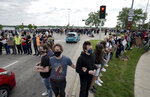 Protesters block an intersection Monday, June 1, 2020, in Madison, Wis. Several hundred protesters marched through and blocked all six lanes of John Nolan Drive as part of what they say will be a week of action against police brutality and
