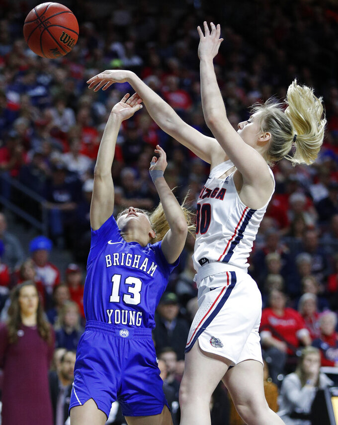 Gonzaga's Chandler Smith blocks a shot by BYU's Paisley Johnson during the first half of an NCAA women's final college basketball game at the West Coast Conference tournament, Tuesday, March 12, 2019, in Las Vegas. (AP Photo/John Locher)