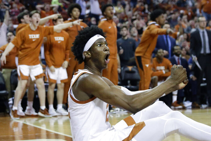 Texas forward Kai Jones (22) celebrates a play during the second half of an NCAA college basketball game against West Virginia, Monday, Feb. 24, 2020, in Austin, Texas. (AP Photo/Eric Gay)