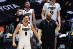 Purdue forward Mason Gillis (0) celebrates on the bench in the final minutes of the second half of an NCAA college basketball game against Wisconsin in West Lafayette, Ind., Tuesday, March 2, 2021. Purdue defeated Wisconsin 73-69. (AP Photo/Michael Conroy)