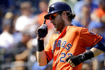 Houston Astros' Josh Reddick celebrates as he scores on a two-run double by Abraham Toro during the third inning of a baseball game against the Kansas City Royals Sunday, Sept. 15, 2019, in Kansas City, Mo. (AP Photo/Charlie Riedel)
