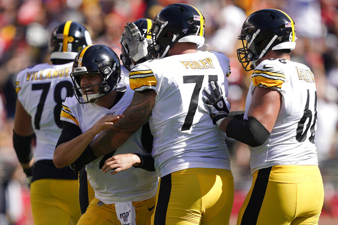 Pittsburgh Steelers quarterback Mason Rudolph, center left, celebrates with teammates after throwing a touchdown pass to wide receiver JuJu Smith-Schuster during the second half of an NFL football game against the San Francisco 49ers in Santa Clara, Calif., Sunday, Sept. 22, 2019. (AP Photo/Tony Avelar)
