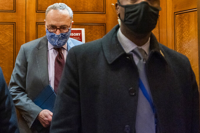 Senate Majority Leader Chuck Schumer of N.Y, takes the elevator in the U.S. Capitol , Friday, Jan. 22, 2021, in Washington. (AP Photo/Manuel Balce Ceneta)