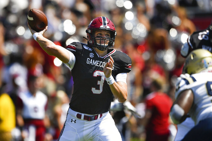 South Carolina quarterback Ryan Hilinski (3) drops back to pass as Charleston Southern defensive lineman Shaundre Mims defends, right, during the first half of an NCAA college football game Saturday, Sept. 7, 2019, in Columbia, S.C. (AP Photo/John Amis)