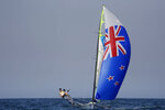 FILE - In this Aug. 15, 2016, file photo, New Zealand's Peter Burling, left, and Blair Tuke compete during their 49er Men race at the Summer Olympics in Rio de Janeiro. As they hit what could be the prime of their careers, Burling, 30, and Tuke, 31, are thinking about more than just their next victory. Sure, they're focusing in on trying to win another gold medal in the high-performance 49er skiff in the Tokyo Olympics starting later this month. They also realize that as the victories pile up, they're in a unique position to speak out about protecting the planet's oceans. (AP Photo/Gregorio Borgia, File)