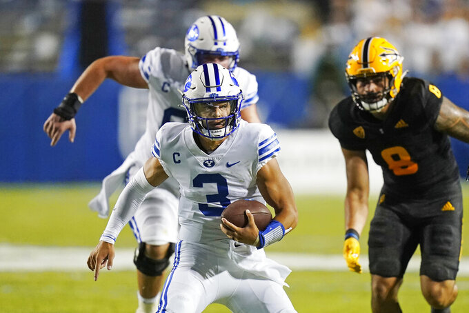 BYU quarterback Jaren Hall (3) carries the ball against Arizona State during the first half of an NCAA college football game Saturday, Sept. 18, 2021, in Provo, Utah. (AP Photo/Rick Bowmer)