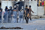 Riot police close al-Rashid St. during ongoing protests in Baghdad, Iraq, Sunday, Nov. 17, 2019. (AP Photo/Hadi Mizban)