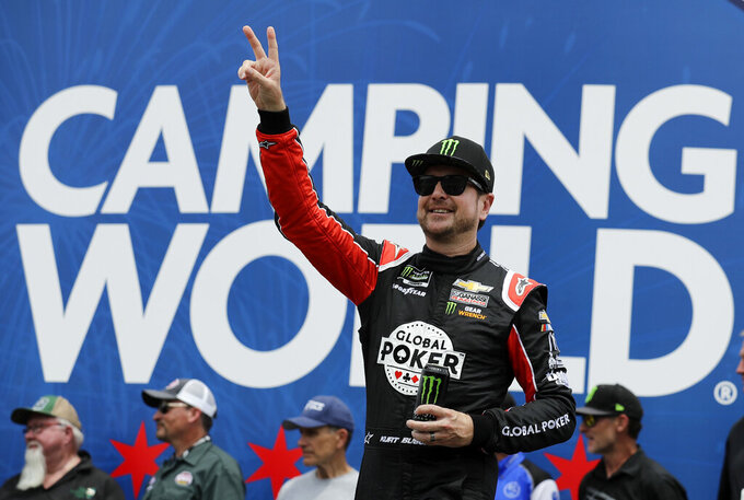 Kurt Busch greets fans during driver introductions before a NASCAR Cup Series auto race at Chicagoland Speedway in Joliet, Ill., Sunday, June 30, 2019. (AP Photo/Nam Y. Huh)