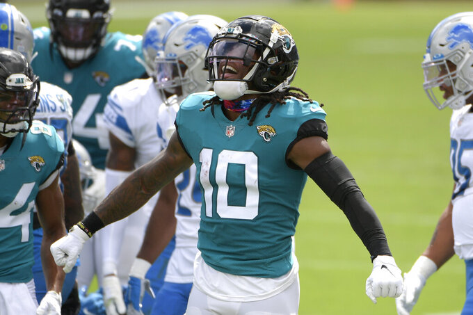 Jacksonville Jaguars wide receiver Laviska Shenault Jr. (10) celebrates after a reception against the Detroit Lions during the first half of an NFL football game, Sunday, Oct. 18, 2020, in Jacksonville, Fla. (AP Photo/Phelan M. Ebenhack)