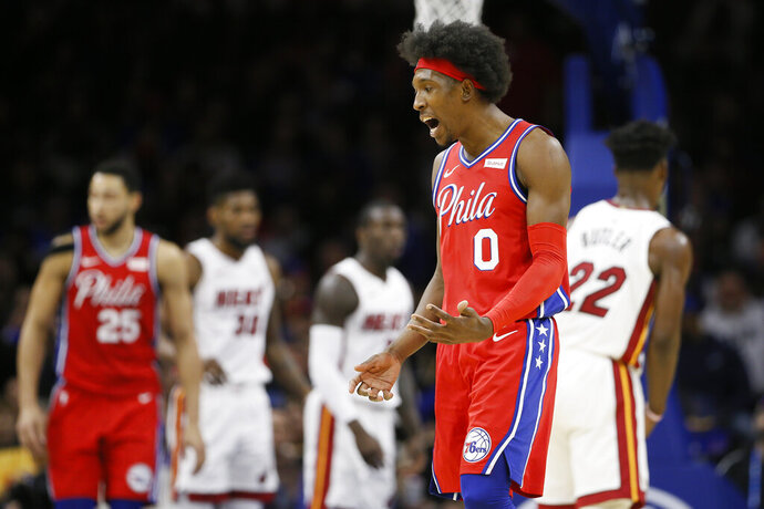 Philadelphia 76ers' Josh Richardson (0) reacts after a basket during the first half of an NBA basketball game against the Miami Heat, Saturday, Nov. 23, 2019, in Philadelphia. (AP Photo/Matt Slocum)