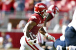 Arkansas defensive back Jalen Catalon (1) returns an interception against Rice during the second half of an NCAA college football game Saturday, Sept. 4, 2021, in Fayetteville, Ark. (AP Photo/Michael Woods)