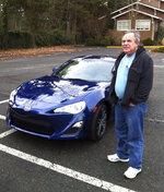In this Dec. 14, 2013, photo provided by Shashi Karan, Alan Naiman poses with his new car, an unusual extravagance for him, in Seattle. When Naiman, a Washington state social worker, died this year of cancer at the age of 63, the generous loner left most of his surprise estate worth $11 million to children's charities helping the poor, sick, disabled, abandoned and those otherwise stuck in foster care, unbeknownst to those beneficiaries or his own loved ones. (Shashi Karan via AP)