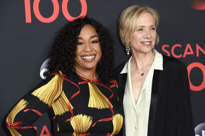 "FILE - Producers Shonda Rhimes, left, and Betsy Beers attend the ""Scandal"" 100th Episode Celebration on April 8, 2017, in West Hollywood, Calif. Rhimes and Beers will be honored for their wardrobe efforts  with the Distinguished Collaborator Award for projects like ""Grey's Anatomy"" and ""Bridgerton"" at the Costume Designers Guild Awards. (Photo by Richard Shotwell/Invision/AP, File)"