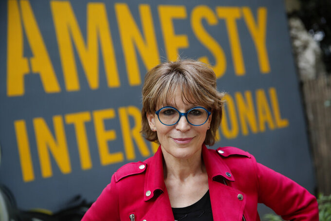 Amnesty International Secretary General Agnes Callamard poses in Paris, Tuesday, April 6, 2021. Agnes Callamard is best known for her investigation into the killing of Saudi journalist Jamal Khashoggi, and has made a career uncovering extra-judicial killings. The French human rights expert's focus on rights abuses is taking on new dimensions as she assumes leadership of Amnesty International and turns her attention to what she says is one of the world's most pressing rights issues — vaccine equity. (AP Photo/Christophe Ena)