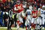 Kansas City Chiefs nose tackle Derrick Nnadi (91) celebrates a tackle of Indianapolis Colts running back Marlon Mack during the first half of an NFL divisional football playoff game in Kansas City, Mo., Saturday, Jan. 12, 2019. (AP Photo/Ed Zurga)