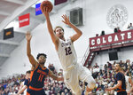 Colgate center Dana Batt (12) drives for a layup in front of Bucknell guard Avi Toomer (11) during the second half of an NCAA college basketball game for the championship of the Patriot League men's tournament in Hamilton, N.Y., Wednesday, March 13, 2019. Colgate won 94-80. (AP Photo/Adrian Kraus)