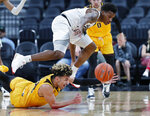 Colorado's Eli Parquet, top, and Wyoming's Hunter Maldonado scramble for the ball during the first half on an NCAA college basketball game Sunday, Nov. 24, 2019, in Las Vegas. (AP Photo/John Locher)