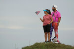 Fans watch from the 15th hole during a Ryder Cup singles match at the Whistling Straits Golf Course Sunday, Sept. 26, 2021, in Sheboygan, Wis. (AP Photo/Charlie Neibergall)