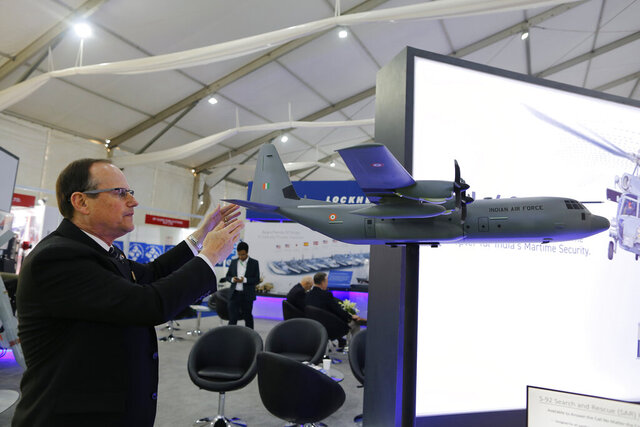 FILE - In this Feb. 7, 2020, file photo, Richard Johnston, Director International Business Development, Air Mobility & Maritime Missions, Lockheed Martin, explains the workings of the C-130J Super Hercules during the DefExpo20 in Lucknow, India. New Zealand's military said Friday, June 5, 2020, it will buy five Super Hercules transport planes from Lockheed Martin for $1 billion. (AP Photo/Rajesh Kumar Singh, File)