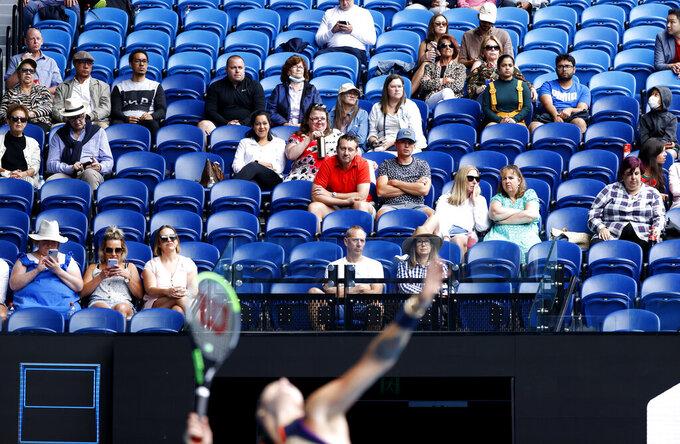 Spectators watch the third round match between Aryna Sabalenka of Belarus and United States' Ann Li at the Australian Open tennis championship in Melbourne, Australia, Friday, Feb. 12, 2021.(AP Photo/Rick Rycroft)