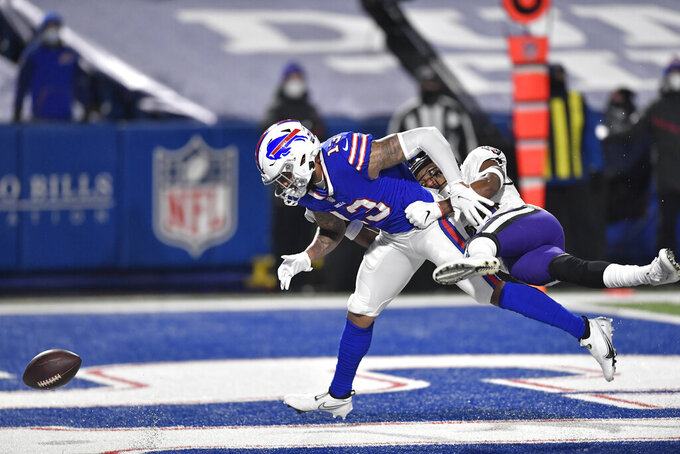 Baltimore Ravens' Marlon Humphrey, right, defends Buffalo Bills' Gabriel Davis (13) during the first half of an NFL divisional round football game Saturday, Jan. 16, 2021, in Orchard Park, N.Y. (AP Photo/Adrian Kraus)