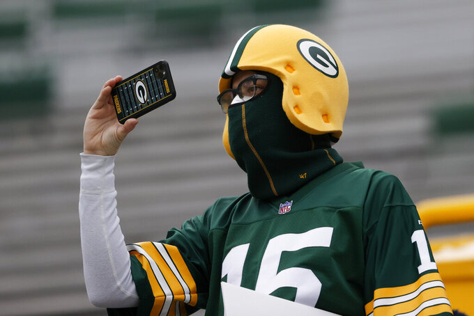 A Packers supporter takes a photo before the NFC championship NFL football game between the Tampa Bay Buccaneers and Green Bay Packers in Green Bay, Wis., Sunday, Jan. 24, 2021. (AP Photo/Jeffrey Phelps)
