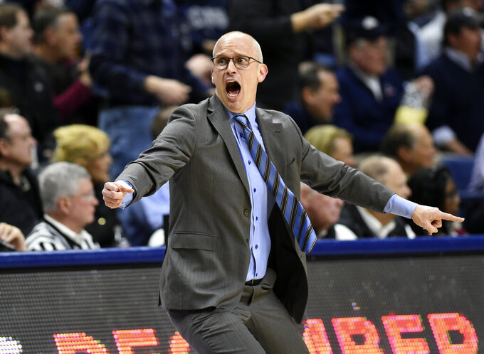 Connecticut head coach Dan Hurley reacts to a foul call in the first half of an NCAA college basketball game against Temple, Thursday, March 7, 2019, in Storrs, Conn. (AP Photo/Stephen Dunn)