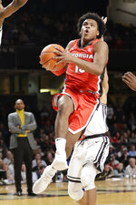 Georgia guard Sahvir Wheeler drives against Vanderbilt in the first half of an NCAA college basketball game Saturday, Feb. 22, 2020, in Nashville, Tenn. (AP Photo/Mark Humphrey)