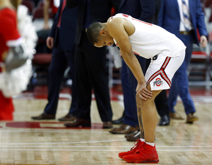 Ohio State guard CJ Walker reacts following an NCAA college basketball game loss to Wisconsin in Columbus, Ohio, Friday, Jan. 3, 2020. (AP Photo/Paul Vernon)
