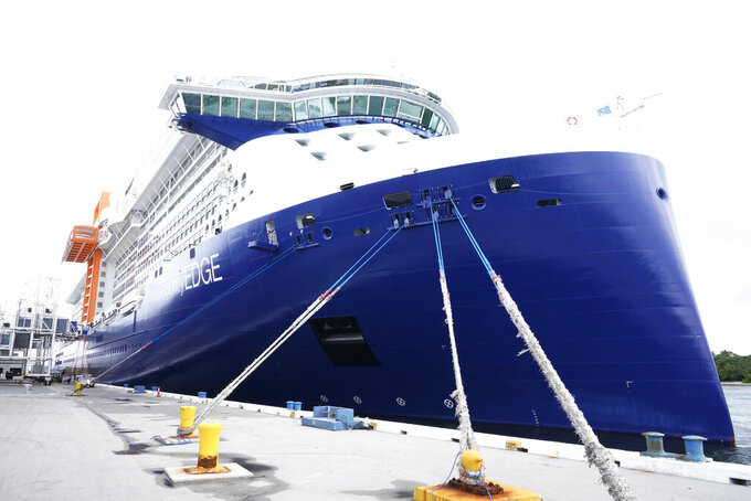 The Celebrity Edge is moored at Port Everglades, Saturday, June 26, 2021, in Fort Lauderdale, Fla. Celebrity Edge is the first cruise ship to leave a U.S. port since the coronavirus pandemic brought the industry to a 15-month standstill. The seven-night cruise will have 40 percent capacity and with virtually all passengers vaccinated against COVID-19.(AP Photo/Marta Lavandier)